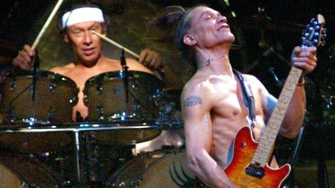 Eddie Van Halen strums along on his guitar Saturday night during Van Halen's concert at the Worcester Centrum Centre.
