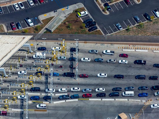 This April 2, 2019, photo shows the port of entry from Mexicali, Mexico to Calexico, Calif. The Trump administration has reassigned so many inspectors from U.S.-Mexico border crossings that it has caused huge traffic backups for truckers who are waiting in line for hours and in some case days to get shipments to the U.S. (Mark Holtzman/West Coast Aerial Photography Inc. via AP)