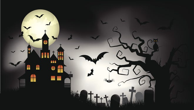 Spooky Halloween background with a haunted house.