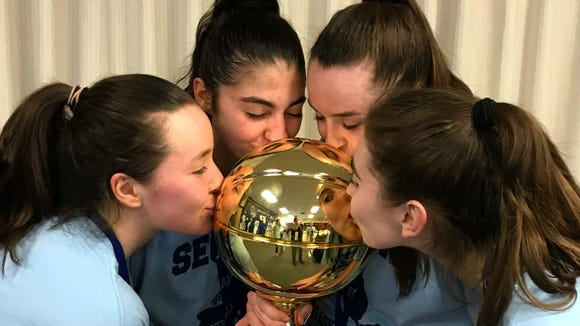 Irvington seniors (from left) Heather Hall, Olivia Valdes, Kelly Degnan, and Mary Brereton kiss their fourth gold ball won together after winning the Section 1 Class B championship on Sunday, Mar. 4, 2018.