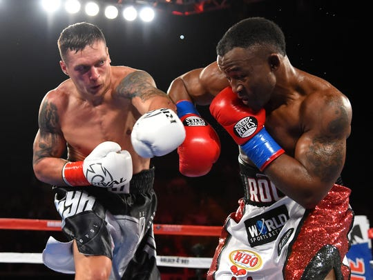 Oleksandr Usyk, left, defeated Thabiso Mchunu in their WBO cruiserweight title fight at The Forum.