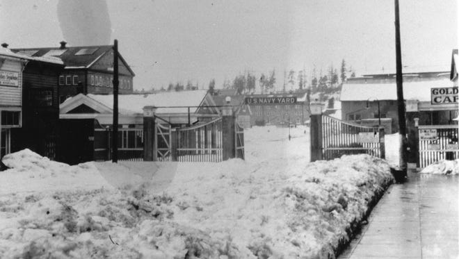 The year 1916 brought an unusually cold and blustery winter to Kitsap County. During one 24-hour period, 2 feet of snow is said to have fallen on top of the 2 feet already on the ground. Shown here is the Front Street (First Street) gate into the Navy Yard after a February 1916 snow storm. To see more photos from the Kitsap County Historical Society Museum archives, visit www.facebook.com/kitsaphistory or stop by the museum at 280 Fourth St. in Bremerton. Call 360-479-6226 for information.