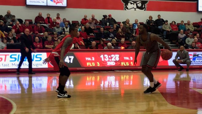 Austin Peay guard Tre' Ivory carries the ball up the court against SEMO.