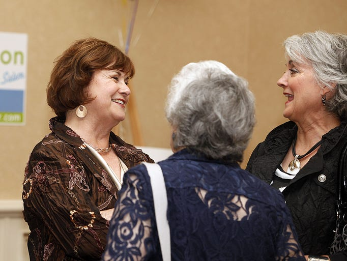 Mayor Anna Peterson (from left) chats with guests Peggy Garrison and Theresa Richardson at her election night party at the Salem Convention Center Tuesday evening May 20, 2014.