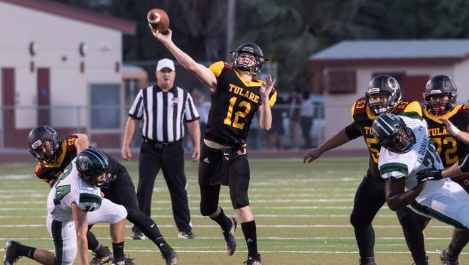 Tulare Union's Nathan Lamb passes against El Diamante in a non-league high school football game  on Thursday, August 23, 2018.