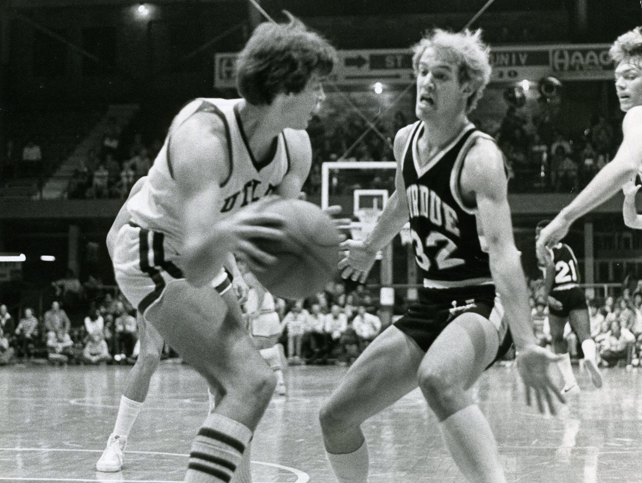 Kevin Stallings, right, played for Purdue's 1980 Final Four team. He later started for the Boilermakers and led the team in assists in 1981-82.