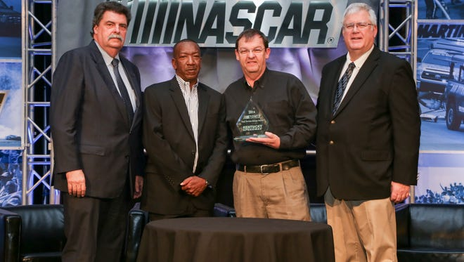 (Left to right) Mike Helton, NASCAR President; Mike Phillips, Director, NASCAR Track Services; Tony Morgan, Fire and Safety Manager, Kentucky Speedway; David Hoots, Managing Event Director, NASCAR Race Services