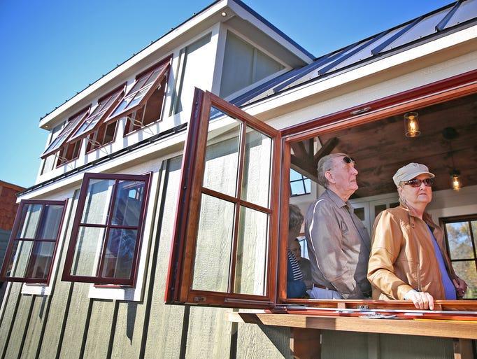 Don and Jan Vera walk through a Timbercraft Tiny Homes