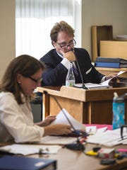 David Dismukes, an expert witness appearing on behalf of opponents of a proposed Vermont Gas pipeline, top, is questioned by Kimberly Hayden, an attorney representing Vermont Gas, during a hearing before the Public Service Board which is considering the project in Montpelier on Tuesday, June 23, 2015.