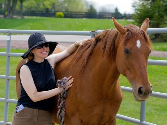 Dr. Maria Katsamanis, founder of Horses for Healers Workshop, spends time with Syriana at Foxx Creek Farm in Hillsborough.