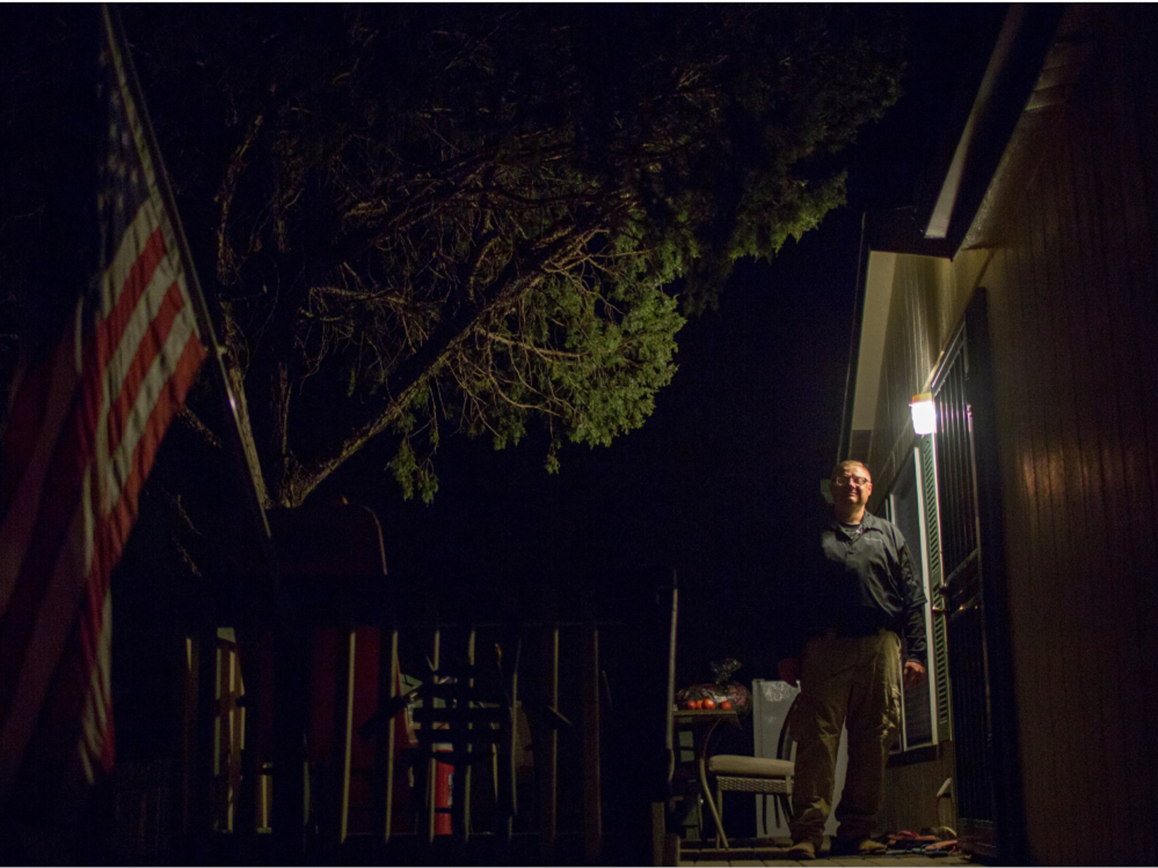 Doug Stewart stands outside his home on in Payson.
