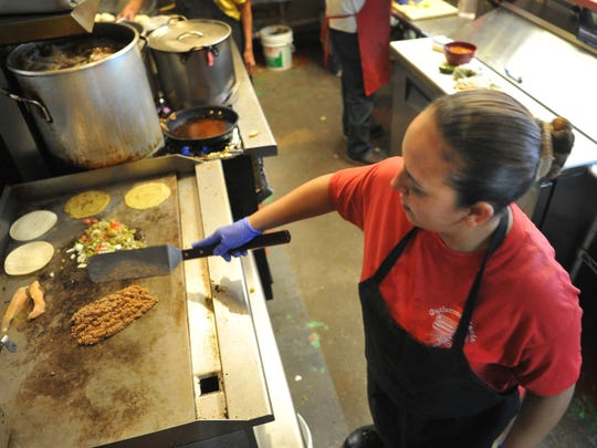 Gutierrez restaurant, owner, Rosa Villegas, and her kitchen staff prepares Eat Well menu item Thursday. Eat Well menu items can be found at 32 Wichita Falls restaurant locations and is part of a joint effort between the Health District and the Health Coalition of Wichita Falls.