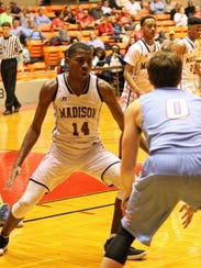 Madison High School's James Anderson guards Gibson