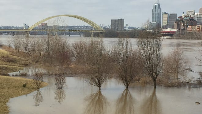 Flooding encroaches on a back yard in Bellevue, Kentucky.