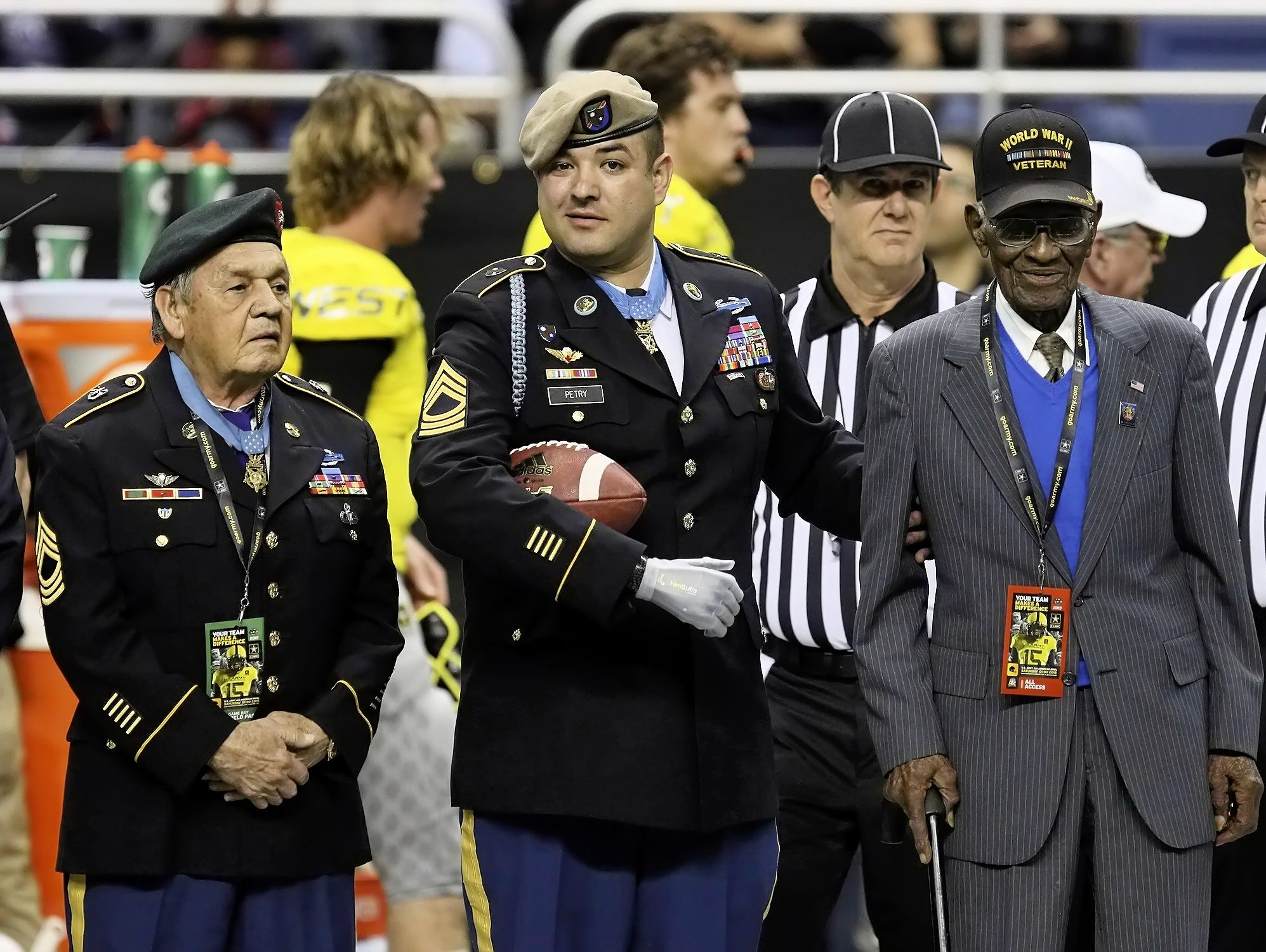 Jose Rodela, left, stands with two other Medal of Honor recipients, Leroy Petry, center, and Richard Overton, before Saturday's All-American Bowl.