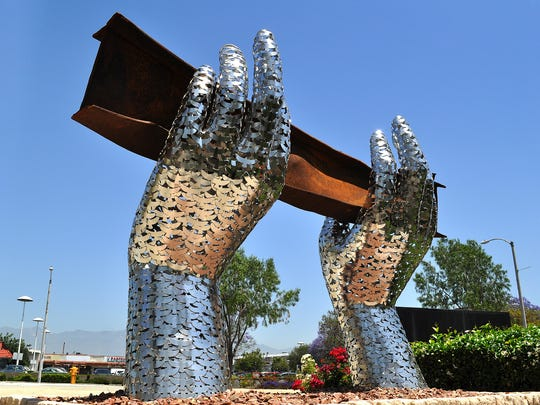 Heath Satow's Sept. 11 memorial was commissioned by the city of Rosemead. The 7-feet-tall, 10-feet wide sculpture depicts two giant hands made up of nearly 3,000 stainless-steel doves lifting a steel beam from the World Trade Center.