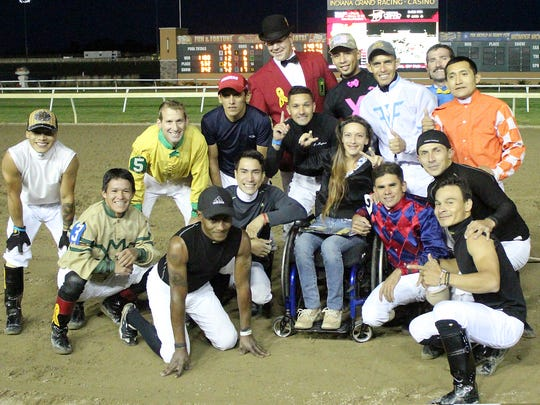 Oriana Ross is surrounded by jockeys Sept. 12 at Indiana Grand.