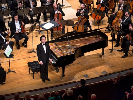 Evgeny Kissin takes a bow during one of four standing ovations for his playing.