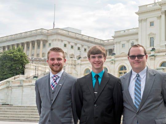 Local delegates were. from left, Adam Barker, Spokane;