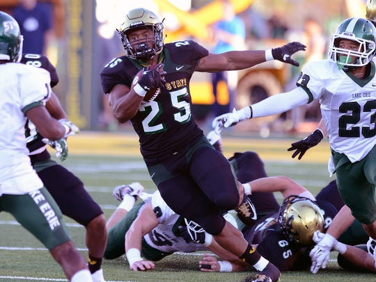 Wayne State's Romello Brown carries the ball during