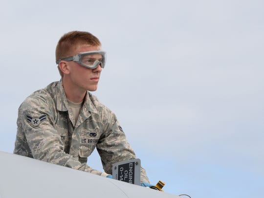 Airman 1st Class John McCulloch, A-10 Crew Chief, 175th Maintenance Squadron, Maryland Air National Guard, works on an A-10C during Exercise Red Flag at Alaska 14-3, Eielson Air Force Base, in 2014.