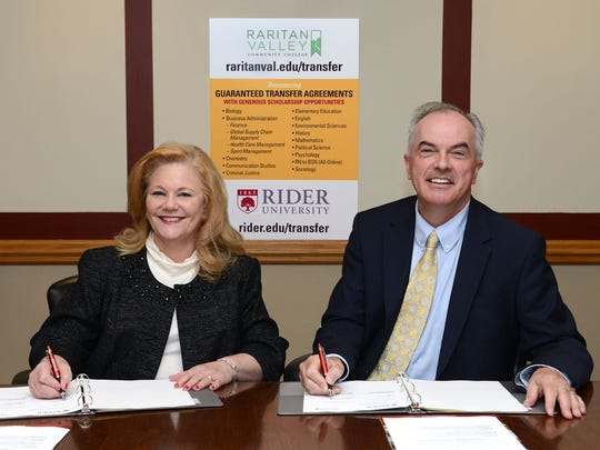 Dr. DonnaJean A. Fredeen, Rider University Provost and Vice President for Academic Affairs, and RVCC President Dr. Michael J. McDonough sign the Program to Program Guaranteed Transfer Agreement on Sept. 23 at RVCC's Branchburg campus.