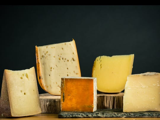 One of Fromaginations cheese gift sets included Emmi Roth's Gran Cru Reserve (from left), MarIeke's Fenugreek Gouda, Roelli's Red Rock, Upland's Pleasant Ridge Reserve, Bleu Mont Bandaged Cheddar