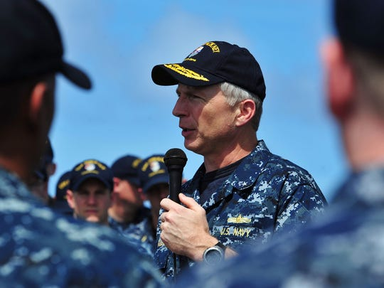 Rear Adm. Craig S. Faller, commander of Carrier Strike Group 3, talks to the crew aboard the Arleigh Burke-class guided-missile destroyer USS Pinckney during an all-hands call. Pinckney is part of the John C. Stennis Carrier Strike Group and is operating in the U.S. 7th Fleet area of responsibility conducting maritime security operations.