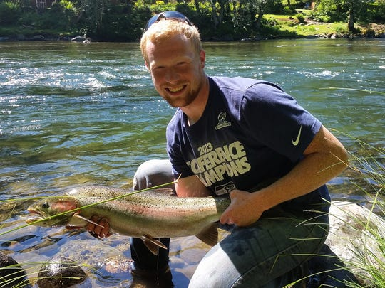 Uriah Kuehl shows off a steelhead he caught near Mill City on the North Santiam River.