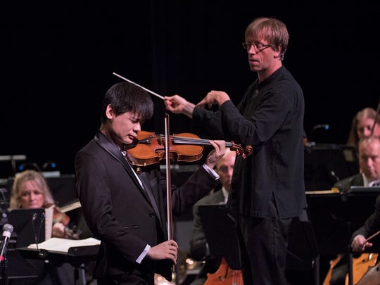 The new CCO music director Eckart Preu, right, with violinist Angelo Xiang Yu.