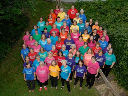The women of the Womansong choral group.