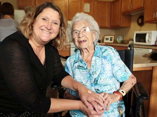 Suzanne Burke, Council on Aging President and CEO, with Florence, Hamilton County Elderly Services Program client, age 104.