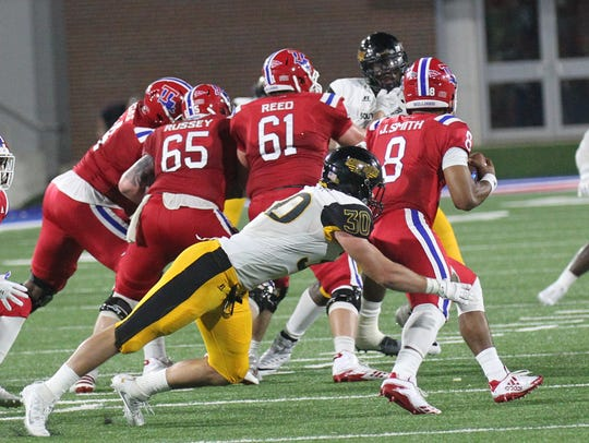 Southern Miss' Paxton Schrimsher goes for a tackle
