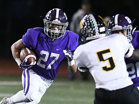 RFH's (27) Peter Crowley looks for running room as Monmouth Regional's (5) Nayson Brown moves in. Football: Monmouth Regional at Rumson -  Fair Haven on 10/27/2017  (Larry Murphy | for the Asbury Park Press)