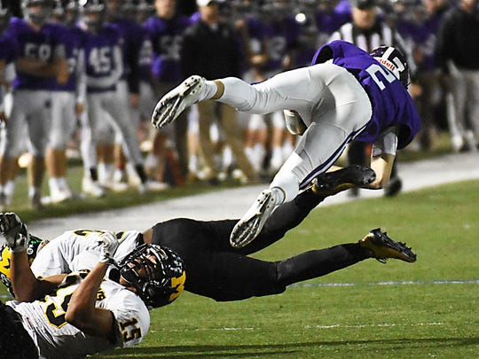 Rumson - Fair Haven's Dan Harby dives for a 1st down in the 2nd quarter vs. Monmouth Regional. Football: Monmouth Regional at Rumson -  Fair Haven on 10/27/2017  (Larry Murphy | for the Asbury Park Press)
