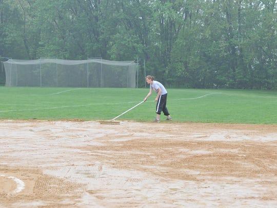 Girls' softball Heah Coach Karyn Albaneius trying to