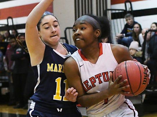 Neptune's Taylor Gardner drives past Marlboro's Samantha Nocco. Girls Basketball: Opening day, Marlboro at Neptune on 12/15/2017  ( Larry Murphy | For the Asbury Park Press)