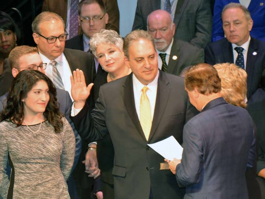 Assemblyman Roy Freiman is sworn in to office Tuesday in Trenton.