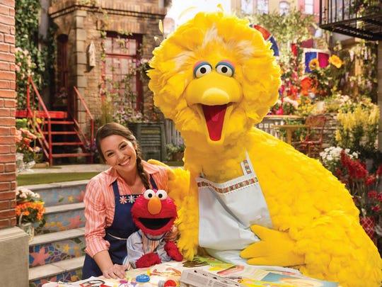 "Bird Bird, Elmo and Suki Lopez (Nina) star in ""Sesame Street."""