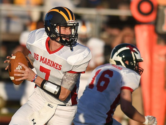 Leather Neck QB Jared Pershyn ( Del Val) looks to pass