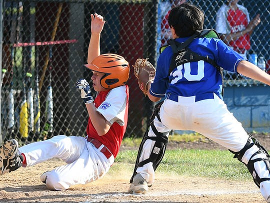 Brick Twp's catcher Dave Yorke tags out Ocean Twp's