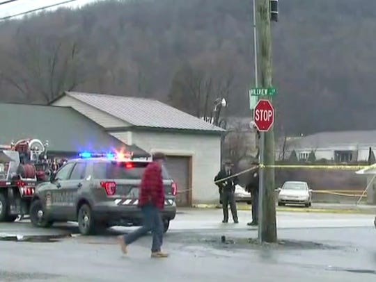 In this frame from video, police work at the scene