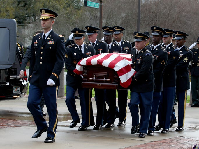 An honor guard carries former FL Governor Reubin Askew's body into FloridaÕs Historic Capitol on Tuesday morning.
