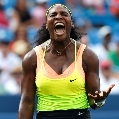 Serena Williams (USA) reacts to a shot in the tiebreaker