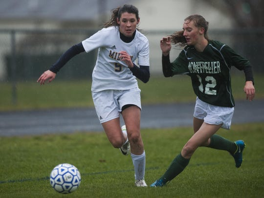 Montpelier's Lily Fournier (12) and Milton's Carlie Reen (5) battle for the ball during the Division I high school girls soccer semifinals Wednesday.
