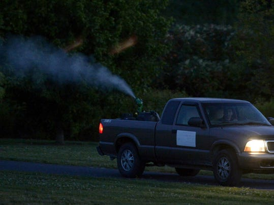 David Schmidt of the Lancaster County West Nile Program sprays mosquitoes in the Myerstown Area in 2014. A truck like this one will spray in Adams County later this week.