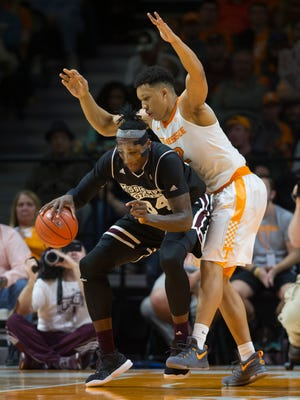 Mississippi State's Schneider Herard (34) fights past Tennessee's Grant Williams (2).