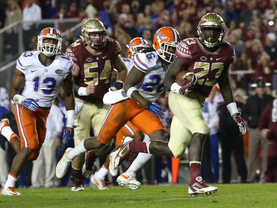 FSU's Freddie Stevenson rces to the endzone for a touchdown