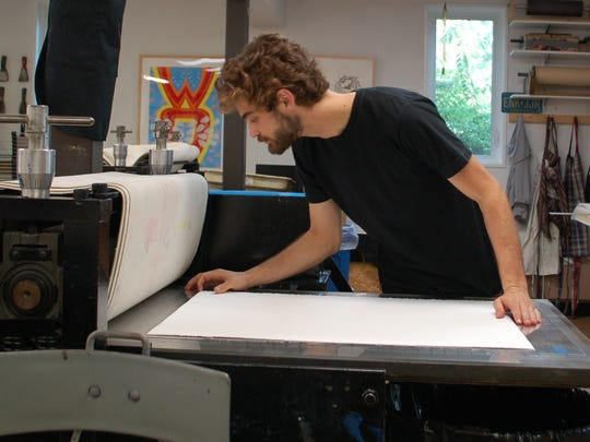 Devin Kovach, the 2014 Konrad Artist in Residence at the Printmaking Center of New Jersey, creating a monotype print in the studio.