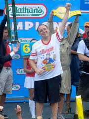Joey Chestnut won Nathan's July 4th hot dog eating contest in 2014, despite heavy rainfall from hurricane Arthur.